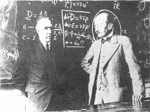 Neils Bohr and Max Planck in Front of Maxwell's Equations